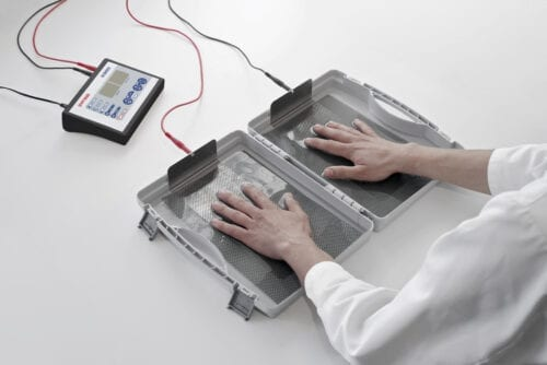 DVP1000 Ultimate Iontophoresis Machine Treating Excessively Sweaty Hands